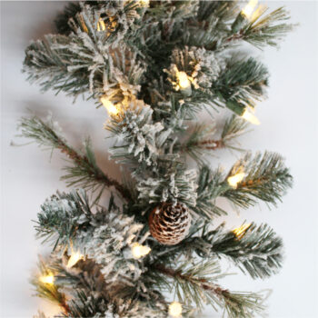 9-foot Snowy Spruce Artificial Christmas Garland Pre-lit with 100 Clear Incandescent Lights